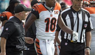 Cincinnati Bengals wide receiver A.J. Green (18) is escorted off the field after he was involved in an altercation with players from the Jacksonville Jaguars during the first half of an NFL football game, Sunday, Nov. 5, 2017, in Jacksonville, Fla. (AP Photo/Stephen B. Morton)