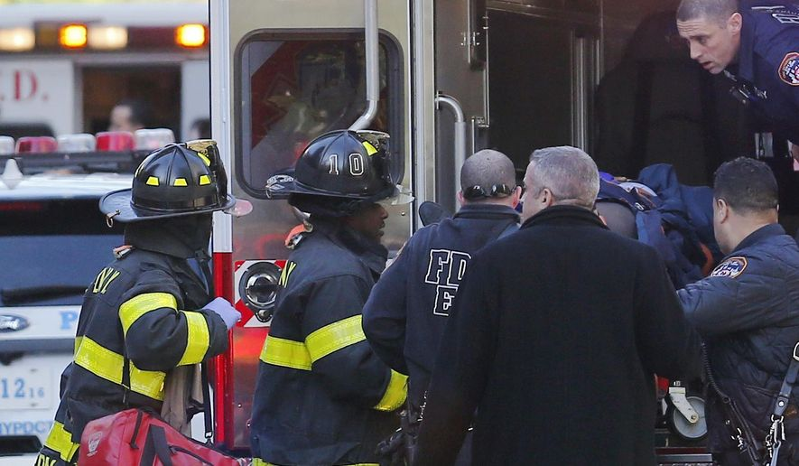In this Oct. 31, 2017 file photo, paramedics lift an individual into an ambulance near New York City's World Trade Center in New York.  A terrorist truck attack on a Manhattan bike path that killed eight people, five of them friends visiting from Argentina, also took a devastating toll on another group of foreign tourists. Three members of a family from Belgium were among a dozen people hospitalized, including the most severely wounded of all, Marion Van Reeth, a mother whose legs were so badly mangled they had to be amputated. (AP Photo/Bebeto Matthews, File)