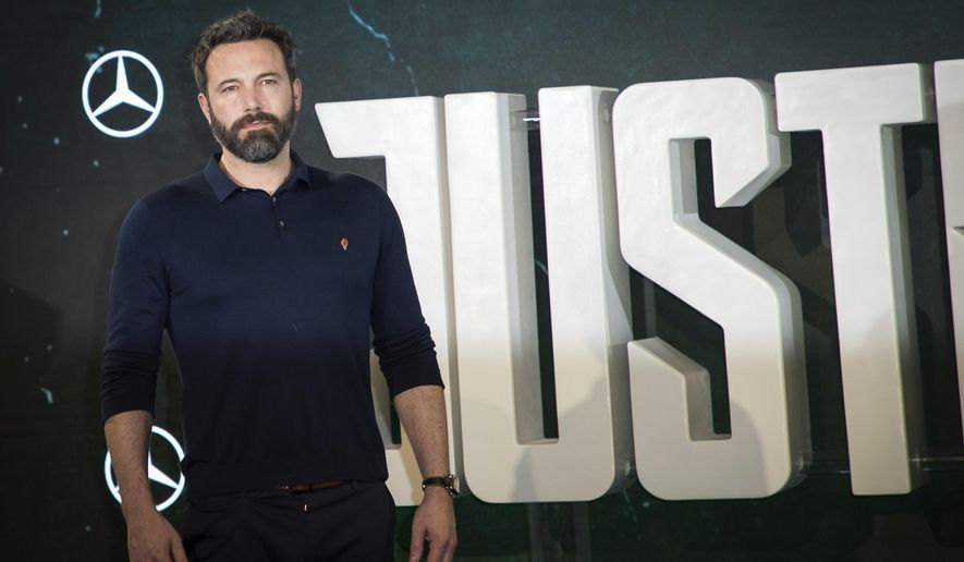 Actor Ben Affleck poses for photographers at a photo call to promote the film 'Justice League', in London, Saturday, Nov. 4, 2017. (Photo by Vianney Le Caer/Invision/AP)