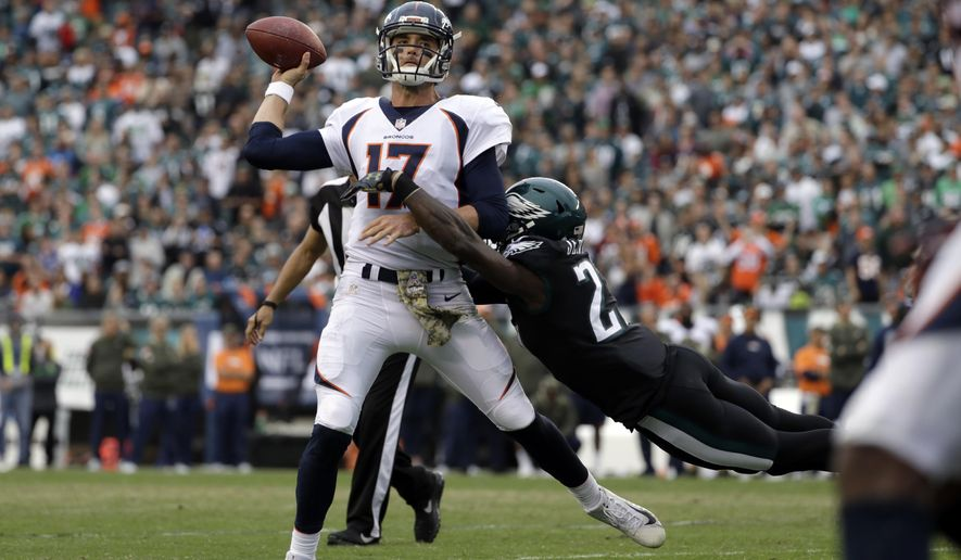 Denver Broncos' Brock Osweiler (17) is tackled by Philadelphia Eagles' Malcolm Jenkins during the second half of an NFL football game, Sunday, Nov. 5, 2017, in Philadelphia. (AP Photo/Michael Perez)