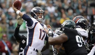 Denver Broncos' Brock Osweiler passes during the first half of an NFL football game against the Philadelphia Eagles, Sunday, Nov. 5, 2017, in Philadelphia. (AP Photo/Matt Rourke)