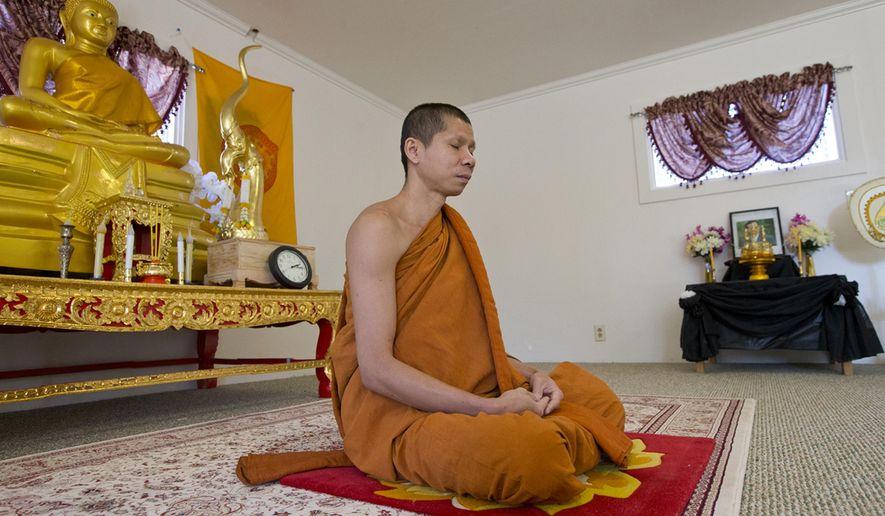 In an Oct. 27, 2017 photo, Singto Korsungnoen, who is a monk, meditates at The International Insight Meditation Center in Redmond Oregon (Andy Tullis/The Bulletin via AP)