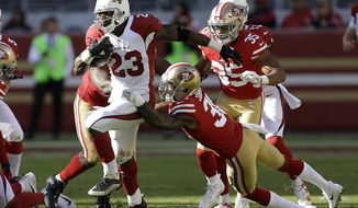 Arizona Cardinals running back Adrian Peterson (23) runs against the San Francisco 49ers during the first half of an NFL football game in Santa Clara, Calif., Sunday, Nov. 5, 2017. (AP Photo/Ben Margot)