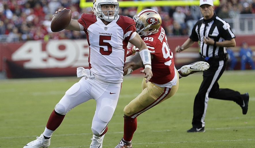Arizona Cardinals quarterback Drew Stanton (5) scrambles from San Francisco 49ers defensive end DeForest Buckner (99) during the second half of an NFL football game in Santa Clara, Calif., Sunday, Nov. 5, 2017. (AP Photo/Marcio Jose Sanchez)
