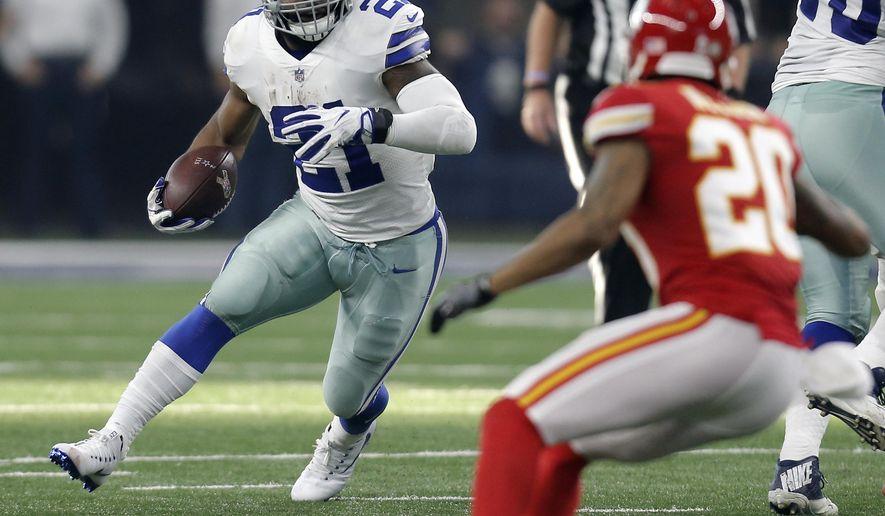 Dallas Cowboys' Ezekiel Elliott (21) looks for running room as Kansas City Chiefs' Steven Nelson (20) gives chase in the first half of an NFL football game, Sunday, Nov. 5, 2017, in Arlington, Texas. (AP Photo/Brandon Wade)