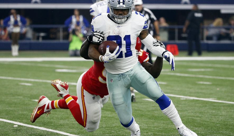 Dallas Cowboys running back Ezekiel Elliott (21) carries the ball as Kansas City Chiefs defensive end Allen Bailey, rear, attempts the stop in the first half of an NFL football game, Sunday, Nov. 5, 2017, in Arlington, Texas. (AP Photo/Michael Ainsworth)