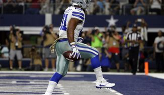 Dallas Cowboys' Ezekiel Elliott high steps as he celebrates running the ball for a touchdown in the second half of an NFL football game against the Kansas City Chiefs on Sunday, Nov. 5, 2017, in Arlington, Texas. (AP Photo/Michael Ainsworth)