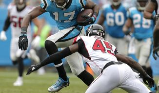 Carolina Panthers' Devin Funchess (17) runs after a catch as Atlanta Falcons' Deion Jones (45) defends in the second half of an NFL football game in Charlotte, N.C., Sunday, Nov. 5, 2017. (AP Photo/Bob Leverone)