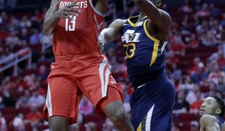 Houston Rockets guard James Harden (13) lays up a shot past Utah Jazz center Ekpe Udoh (33) in the first half of an NBA basketball game Sunday, Nov. 5, 2017, in Houston. (AP Photo/Michael Wyke)
