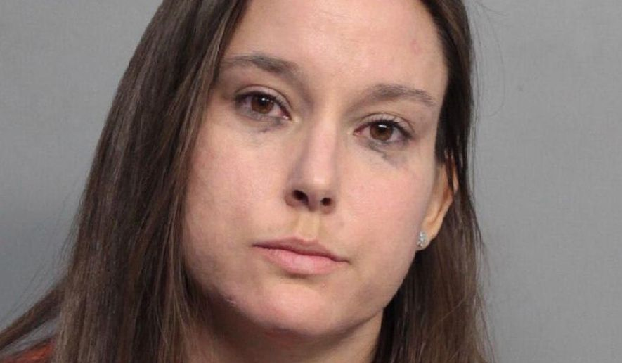 Bridget Freitas is seen in an undated photo provided by the Miami-Dade Police Department. Police have charged Freitas, a 30-year-old nurse, with felony battery on a police officer for her part in a videotaped altercation with a detective at a University of Miami football game. Police said Bridget Freitas slapped an officer while being carried out during Miami's win Saturday, Nov. 4, 2017, over Virginia Tech at Hard Rock Stadium.  (Miami-Dade Police Department via AP)