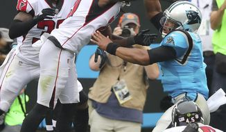 Falcons cornerback Desmond Trufant knocks the ball away from Panthers quarterback Cam Newton as he hits the end zone, but the Panthers recover to take a 14-10 lead during the second quarter in a NFL football game on Sunday, Nov. 5, 2017, in Charlotte. (Curtis Compton/Atlanta Journal-Constitution via AP)