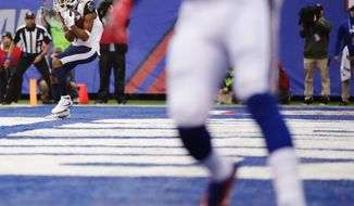 Los Angeles Rams wide receiver Robert Woods (17) catches a pass for a touchdown during the second half of an NFL football game against the New York Giants, Sunday, Nov. 5, 2017, in East Rutherford, N.J. (AP Photo/Julio Cortez)