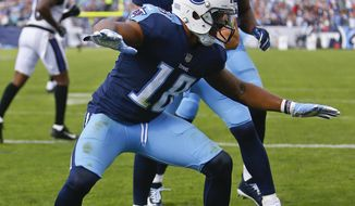 Tennessee Titans wide receiver Rishard Matthews (18) celebrates after catching a 16-yard touchdown against the Baltimore Ravens in the first half of an NFL football game Sunday, Nov. 5, 2017, in Nashville, Tenn. (AP Photo/Wade Payne)