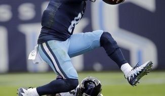 Tennessee Titans quarterback Marcus Mariota (8) leaps over Baltimore Ravens strong safety Tony Jefferson (23) in the first half of an NFL football game Sunday, Nov. 5, 2017, in Nashville, Tenn. (AP Photo/James Kenney)