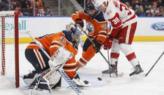 Detroit Red Wings Anthony Mantha (39) scores a goal on Edmonton Oilers goalie Cam Talbot (33) as Darnell Nurse (25) defends during third period NHL hockey action in Edmonton, Alberta, on Sunday, Nov. 5, 2017. (Jason Franson/The Canadian Press via AP)
