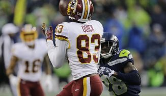Washington Redskins wide receiver Brian Quick makes a catch ahead of Seattle Seahawks cornerback Justin Coleman in the second half of an NFL football game, Sunday, Nov. 5, 2017, in Seattle. The Redskins won 17-14. (AP Photo/Stephen Brashear)