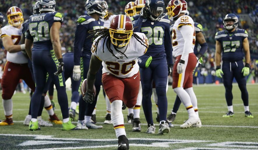 Washington Redskins running back Rob Kelley gets up after scoring a touchdown against the Seattle Seahawks in the second half of an NFL football game, Sunday, Nov. 5, 2017, in Seattle. The Redskins won 17-14. (AP Photo/Elaine Thompson)