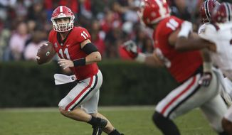 Georgia quarterback Jake Fromm (11) rolls out as he looks for an open receiver during the second half of an NCAA college football game against South Carolina Saturday, Nov. 4, 2017, in Athens, Ga. Georgia won 24-10. (AP Photo/John Bazemore)