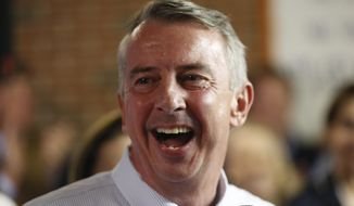 Virginia Republican gubernatorial candidate Ed Gillespie shares a laugh as he attends a get-out-the-vote rally in Williamsburg, Va., Sunday, Nov. 5, 2017. Gillespie faces Democrat Lt. Gov. Ralph Northam in Tuesday's election. (AP Photo/Steve Helber)