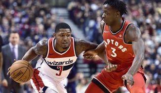 Washington Wizards guard Bradley Beal (3) dribbles the ball under pressure as Toronto Raptors forward OG Anunoby (3) defends during second half NBA basketball action in Toronto on Sunday, Nov. 5, 2017. (Frank Gunn/The Canadian Press via AP)