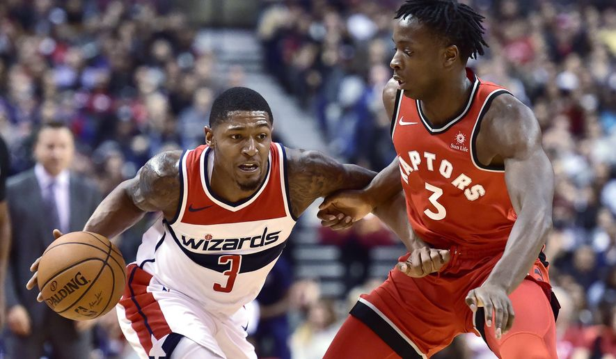 Washington Wizards guard Bradley Beal (3) dribbles the ball under pressure as Toronto Raptors forward OG Anunoby (3) defends during second half NBA basketball action in Toronto on Sunday, Nov. 5, 2017. (Frank Gunn/The Canadian Press via AP)