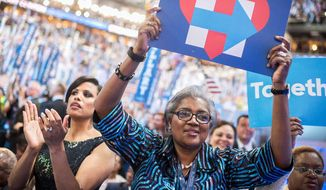 "What once was: Donna Brazile brandishes a Hillary Clinton campaign sign at the 2016 Democratic National Convention, 16 months before the publication of her new book ""Hacked."" (Associated Press) ** FILE **"