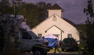 A man walks past the front of the First Baptist Church on Monday, Nov. 6, 2017, where a gunman opened fire on a Sunday service in Sutherland Springs, Texas. (Nick Wagner/Austin American-Statesman via AP)