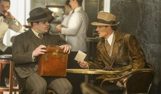 "This image released by Twentieth Century Fox shows Josh Gad, left, and Johnny Depp in a scene from, ""Murder on the Orient Express."" (Nicola Dove/Twentieth Century Fox via AP)"