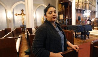 In this Oct. 26, 2017, photo, Amanda Morales poses for a photograph in the sanctuary of the Holyrood Episcopal Church, the Bronx borough of New York. Morales has been living in the gothic church at the northern edge of Manhattan since August, shortly after immigration authorities ordered her deported to her homeland of Guatemala. (AP Photo/Kathy Willens) ** FILE **