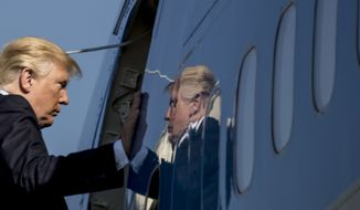 President Donald Trump boards Air Force One at Yokota Air Base in Fussa, Japan, Tuesday, Nov. 7, 2017, to travel to Osan Air Base in Seoul, Korea. Trump is on a five country trip through Asia traveling to Japan, South Korea, China, Vietnam and the Philippines. (AP Photo/Andrew Harnik)