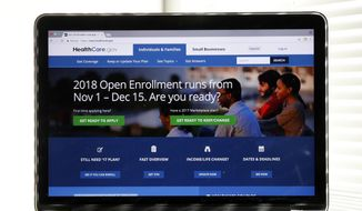 In this Oct. 18, 2017, file photo, the Healthcare.gov website is seen on a computer screen in Washington. (AP Photo/Alex Brandon) ** FILE **