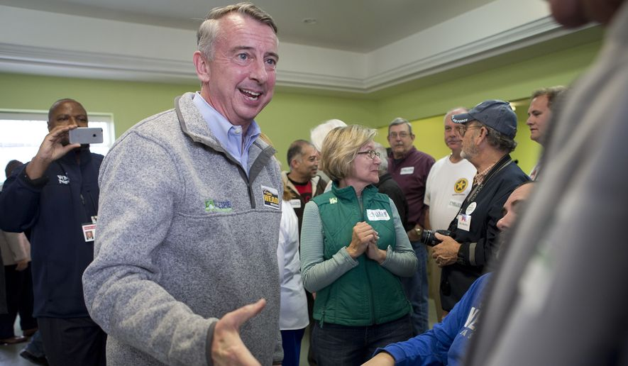 Ed Gillespie, Republican candidate for Virginia governor, did some last-minute campaigning on Monday before facing off against Democrat Ralph Northam at the polls. (Associated Press)