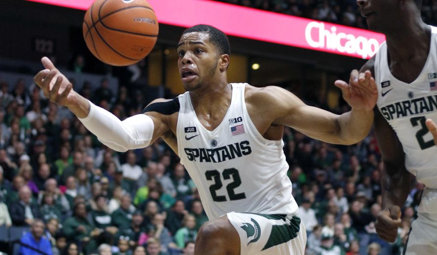 FILE - In this Oct. 29, 2017, file photo, Michigan State's Miles Bridges (22) pulls in the ball as Jaren Jackson Jr. (2) watches during the first half of an NCAA college basketball exhibition game against Georgia in Grand Rapids, Mich. Bridges was selected to The Associated Press preseason All-America team on Monday, Nov. 6, 2017.  AP Photo/Al Goldis, FIle)