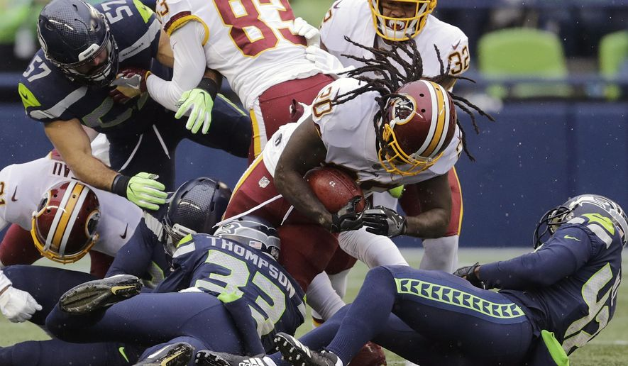 Washington Redskins running back Rob Kelley (20) is tackled by Seattle Seahawks free safety Tedric Thompson (33) while rushing in the first half of an NFL football game, Sunday, Nov. 5, 2017, in Seattle. (AP Photo/Stephen Brashear) **FILE**