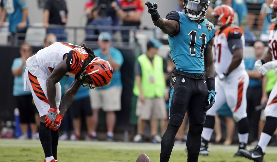 Jacksonville Jaguars wide receiver Marqise Lee (11) points after making a first down against the Cincinnati Bengals during the first half of an NFL football game, Sunday, Nov. 5, 2017, in Jacksonville, Fla. (AP Photo/Stephen B. Morton)