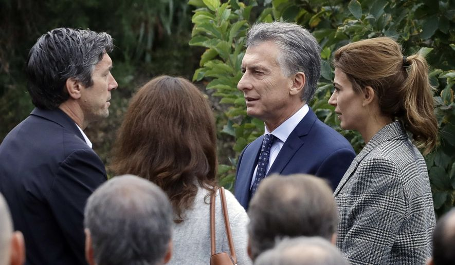 Guillermo Banchini, left, a survivor of the bike path terrorist attack, speaks with Argentine President Mauricio Macri and first lady Juliana Awada at the site of the attack, Monday, Nov. 6, 2017, in New York. Five Argentinians were among eight people killed by the terrorist who drove a truck down the bike path on Tuesday, Oct. 31. (AP Photo/Mark Lennihan)
