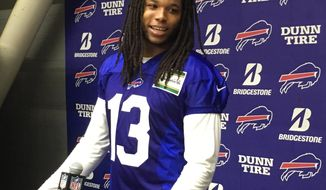 Buffalo Bills' NFL football player Kelvin Benjamin speak to the media in Orchard Park, N.Y., Monday, Nov. 6, 2017. Benjamin is finally set to make his debut with the Bills a week after being acquired in a trade with Carolina. The Bills held out Benjamin from playing against the New York Jets on Thursday, and he's set to play on Sunday, when Buffalo (5-3) hosts New Orleans (6-2).  (AP Photo/John Wawrow)