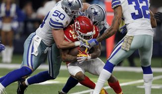 Dallas Cowboys' Sean Lee (50), Byron Jones, rear, and Orlando Scandrick (32) combine to stop Kansas City Chiefs' Charcandrick West (35) after a short run in the first half of an NFL football game, Sunday, Nov. 5, 2017, in Arlington, Texas. (AP Photo/Brandon Wade)