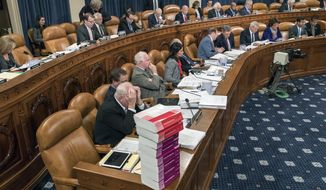 Members of the tax-writing House Ways and Means Committee work to shape the GOP's far-reaching tax overhaul, on Capitol Hill in Washington, Monday, Nov. 6, 2017. (AP Photo/J. Scott Applewhite)