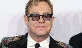 FILE - This Nov. 2, 2016 file photo shows Elton John at the Elton John AIDS Foundation's 15th Annual An Enduring Vision Benefit in New York. The 70-year-old singer will be awarded the Harvard Foundation's Peter J. Gomes Humanitarian Award, for his philanthropic efforts to fight HIV and AIDS, on Monday afternoon, Nov. 6, 2017, at Harvard University in Cambridge, Mass. (Photo by Greg Allen/Invision/AP, File)