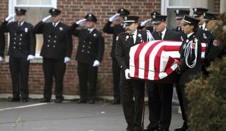 FILE - In this Dec. 31, 2015, file photo, Hamilton, Ohio, firefighters move the casket for Patrick Wolterman into an awaiting fire engine at the Hodapp Funeral Home in Cincinnati. A homeowner and his nephew are scheduled to go on trial in Ohio for murder in a 2015 house fire that resulted in the death of Hamilton firefighter Wolterman. Butler County Judge Greg Stephens said the court should try to seat a jury first. He set jury selection for Monday, Nov. 6. (Cameron Knight/The Cincinnati Enquirer via AP, File)
