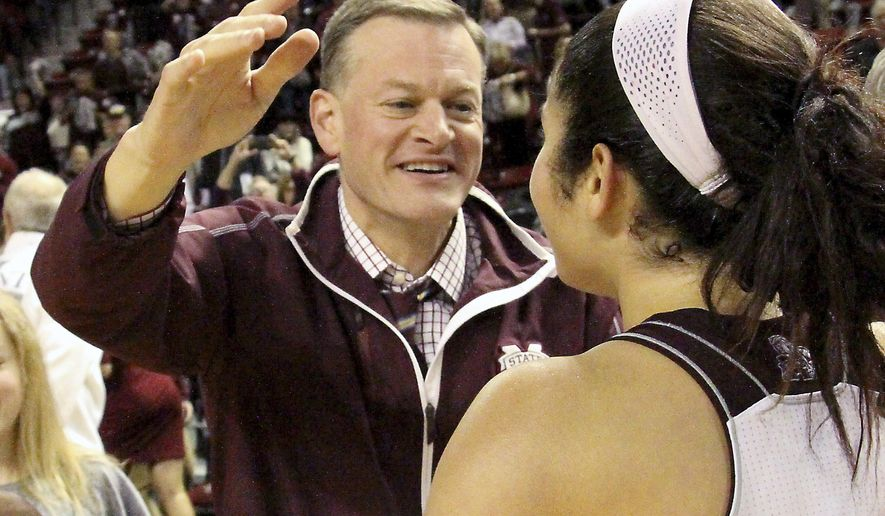 FILE - In this Jan. 28, 2016, file photo, Mississippi State athletic director Scott Stricklin congratulates Dominique Dillingham following the team's NCAA college basketball game against Tennessee in Starkville, Miss. Florida's next coach will have quite a mess to clean up on both sides of the ball. The Gators don't appear to have to a capable quarterback on the roster and now have the program's worst scoring defense in more than 70 years. Florida athletic director Scott Stricklin vowed to hire someone who will the football program fun again. The safe assumption is that means Stricklin will hire a head coach with an offensive background, Monday, Nov. 6, 2017. (AP Photo/Jim Lytle, File)