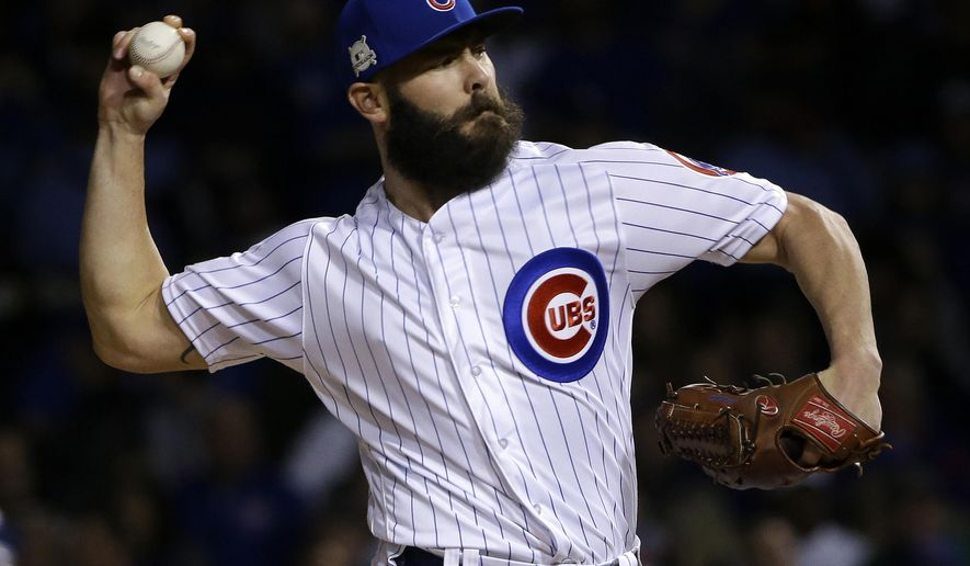 FILE - In this Wednesday, Oct. 18, 2017 file photo, Chicago Cubs starting pitcher Jake Arrieta throws during the first inning of Game 4 of baseball's National League Championship Series against the Los Angeles Dodgers in Chicago. Jake Arrieta and Wade Davis were among nine free agents who have received $17.4 million qualifying offers from their teams, Monday, Nov. 6, 2017.  (AP Photo/Nam Y. Huh, File)