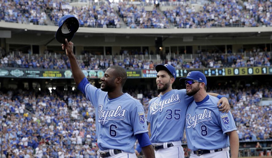 FILE - In this Sunday, Oct. 1, 2017 file photo, veteran Kansas City Royals players Lorenzo Cain (6), Eric Hosmer (35) and Mike Moustakas (8) aknowledge the crowd as they come out of the game during the fifth inning of a baseball game against the Arizona Diamondbacks in Kansas City, Mo. Kansas City Royals first baseman Eric Hosmer, third baseman Mike Moustakas and outfielder Lorenzo Cain were among nine free agents who have received $17.4 million qualifying offers from their teams, Monday, Nov. 6, 2017. (AP Photo/Charlie Riedel, File) **FILE**
