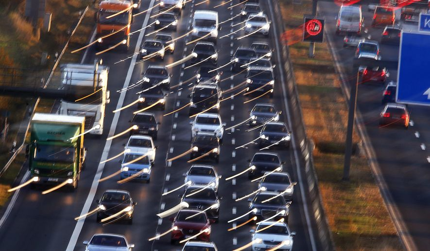 Cars and trucks queue on the highway A5 in Frankfurt, Germany, Monday, Nov. 6, 2017. The World Climate Conference with 25 000 people participating starts on Monday in Bonn, Germany. (AP Photo/Michael Probst)