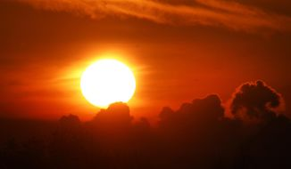The sun rises over Frankfurt, Germany, Monday, Nov. 6, 2017. The World Climate Conference with 25 000 people participating starts on Monday in Bonn, Germany. (AP Photo/Michael Probst)