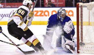 Toronto Maple Leafs goalie Frederik Andersen (31) makes a save against Vegas Golden Knights left wing Erik Haula (56) during the shootout in an NHL hockey game, Monday, Nov. 6, 2017, in Toronto. (Frank Gunn/The Canadian Press via AP)