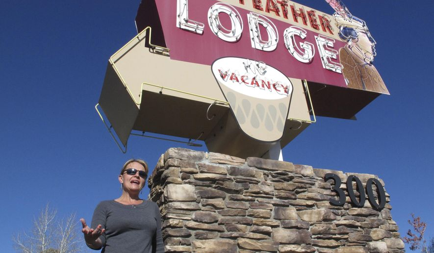 In this Tuesday, oct. 31, 2017 photo, Clarinda Vail stands outside the lodge her family owns in Tusayan, Ariz.. Vail opposes a ballot measure to increase building heights in the small town outside the Grand Canyon's South Rim entrance. (AP Photo/Felicia Fonseca)