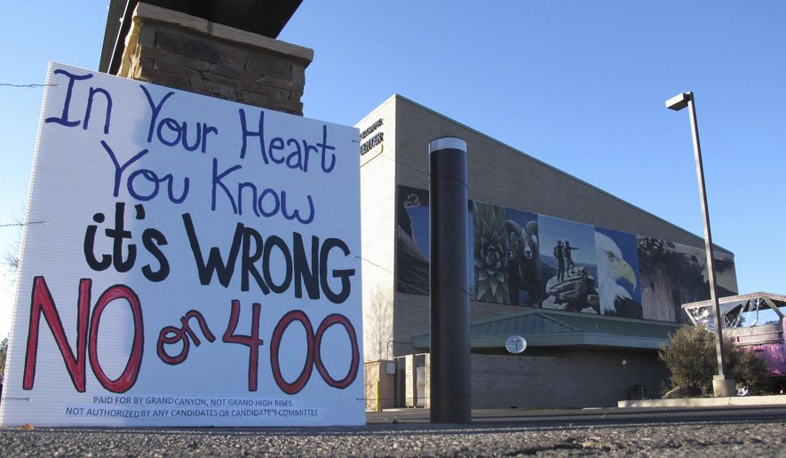 This photo taken Tuesday,  Oct. 31, 2017 urges people to vote against a building height increases in Tusayan, Arizona. A vote in favor would pave the way for development at an RV park in town. (AP Photo/Felicia Fonseca)