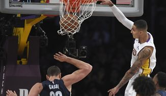 Los Angeles Lakers forward Kyle Kuzma, right, dunks as Memphis Grizzlies center Marc Gasol, of Spain, defends during the first half of an NBA basketball game, Sunday, Nov. 5, 2017, in Los Angeles. (AP Photo/Mark J. Terrill)